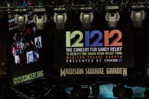 "Signage for the ""12-12-12"" concert (Source: Yahoo! News)"