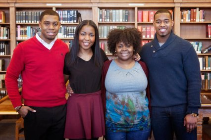 """Howard Project"" participants (left to right) Kevin Peterman, Taylor Davis, Ariel Alford and Leighton Watson in the Howard University library. (Photo Credits: Emily Jan/NPR)"