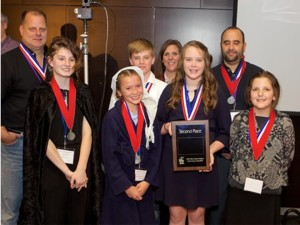 Second Place Team – Arizona Region (Front row, left to right): Megan Hahn (ghost of cities future), Anabelle Dayley (Scrooge), Erin Hildick (Narrator), and Kristine Heckadon (alternate); (Back row, left to right): Damon Hahn - engineer mentor, Christopher Bracken - project manager, Robyn Rice – teacher, and Joseph Szoltysik - teacher