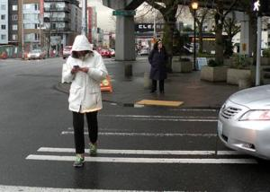 Distracted walker in crosswalk